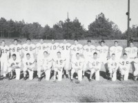 Duluth High Football Team, 1960-61: On the back row: Tommy Brown (30), Jimmy Garmon (66), James Watson (88), Curtis Franklin (38), Tommy Franklin (10), Nelson Anglin (50), Bennie Sharpton (55), Jimmy Hartwick (85),Charles Sewell (65), Don Bullock (75) and Vernon Grafton (80). On the front row are Coach Bill McClure, Philip Mees (25), David Bagley (45), Richard Maddox (77), Johnny Wilson (15), Jeff Burdette (20), Jessy Farmer (68), Billy Powell (50), Kenny Moon (35) and Andy Petty (70).