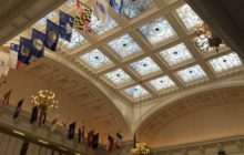 MYSTERY: Glass ceiling, various flags may give clues
