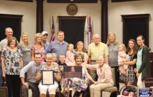 Family all smiles with Dawn P. Gober recognition